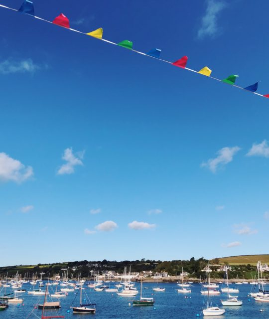Falmouth harbour in the sun with bunting