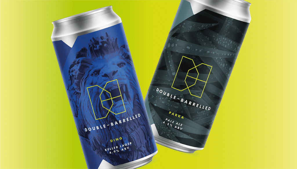 Double barrelled two 440ml craft beer cans on yellow background