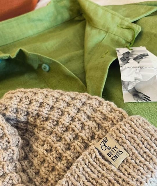 knitted hat and green shirt